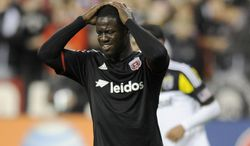 D.C. United forward Eddie Johnson (7) reacts during the second half of an MLS soccer game against the Columbus Crew, Saturday, March 8, 2014, in Washington. Columbus won 3-0. (AP Photo/Nick Wass)