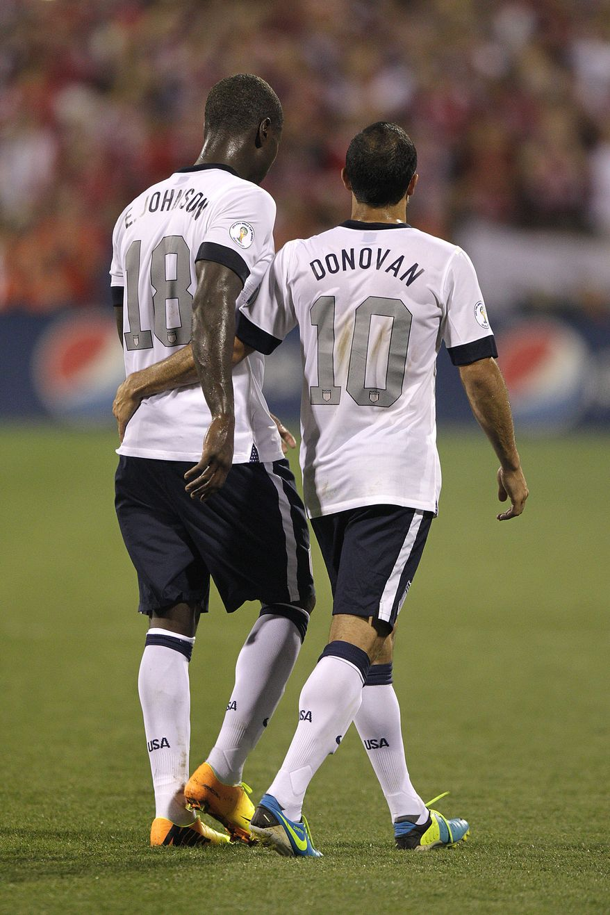 United States' Eddie Johnson, left, and Landon Donovan walk off the field against Mexico in a World Cup qualifying soccer match Tuesday, Sept. 10, 2013, in Columbus, Ohio. (AP Photo/Jay LaPrete)