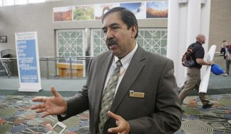 Juan Palma, Utah State Director for the Bureau of Land Management speaks with reporters during the Outdoor Recreation Summit Thursday, May 8, 2014, in Salt Lake City. The U.S. Bureau of Land Management is warning its workers in Utah to be on alert after two men threatened an agency wrangler on Interstate 15 about 90 miles south of Salt Lake City. (AP Photo/Rick Bowmer)