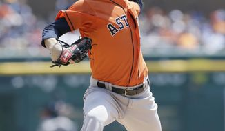 Houston Astros starting pitcher Dallas Keuchel throws during the first inning of a baseball game against the Detroit Tigers in Detroit, Thursday, May 8, 2014. (AP Photo/Carlos Osorio)