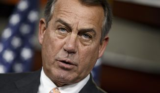 ** FILE ** Speaker of the House John Boehner is asked about the special select committee he has formed to investigate the deadly 2012 attack on the U.S. diplomatic post in Benghazi, Libya, raising the stakes in a political battle with the Obama administration as the midterm election season heats up, during a news conference on Capitol Hill in Washington, Thursday, May 8, 2014. (AP Photo/J. Scott Applewhite)