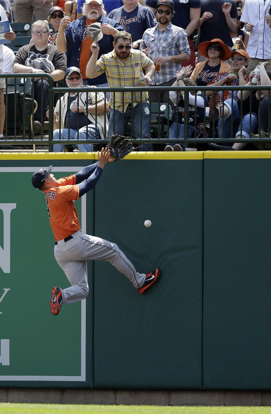 Houston Astros right fielder George Springer misplays the RBI double by Detroit Tigers' Nick Castellanos during the second inning of a baseball game in Detroit, Thursday, May 8, 2014. (AP Photo/Carlos Osorio)