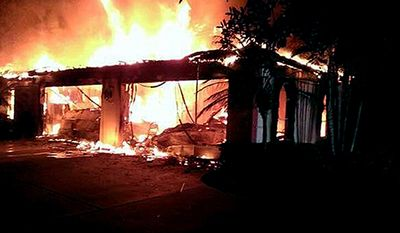 In this photo provided by the Hillsborough County Sheriff's Office, flames destroy a mansion owned by former tennis star James Blake, Wednesday May 7, 2014, in a gated community  in Tampa, Fla. A sheriff's office spokeswoman says detectives are not looking for any suspects in the deaths of four people found in the home, but she stopped short of calling the case a murder-suicide. (AP Photo/Hillsborough County Sheriff's Office)