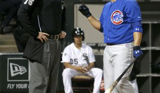 Chicago Cubs' Welington Castillo, right, has words with home plate umpire Tom Woodring, after Castillo was called out on strikes during the sixth inning of an interleague baseball game Wednesday, May 7, 2014, in Chicago. (AP Photo/Charles Rex Arbogast)
