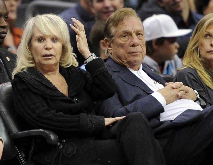 ** FILE ** In this Nov. 12, 2010, file photo, Los Angeles Clippers owner Donald T. Sterling, right, sits with his wife Rochelle during the Clippers NBA basketball game against the Detroit Pistons in Los Angeles. An attorney representing the estranged wife of Clippers owner Donald Sterling said Thursday, May 8, 2014, that she will fight to retain her 50 percent ownership stake in the team. (AP Photo/Mark J. Terrill, File)