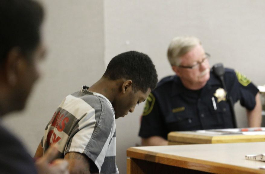 Sir Young, 20, sits in court before a hearing in Dallas Thursday, May 8, 2014.   A district court judge has reversed a previous order and imposed a series of probationary requirements for the 20-year-old man convicted of raping a schoolmate. The initial punishment for Young sparked a backlash when a prior judge in Dallas sentenced him to five years of probation and declined to impose standard conditions of probation for sex offenders. (AP Photo/LM Otero)