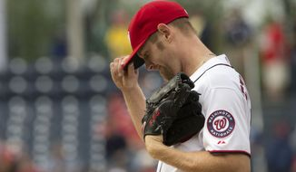 Washington Nationals starting pitcher Stephen Strasburg grabs his cap before being pulled from the baseball game against the Los Angels Dodgers, Wednesday, May 7, 2014 in Washington. Strasburg pitched 7 1/3 innings and threw a total of 114 pitches in a game the Nationals won 3-2. (AP Photo/Pablo Martinez Monsivais)