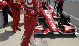 Scott Dixon, of New Zealand, wipes his face following a practice session for the inaugural Grand Prix of Indianapolis IndyCar auto race at the Indianapolis Motor Speedway in Indianapolis, Thursday, May 8, 2014. (AP Photo/Darron Cummings)