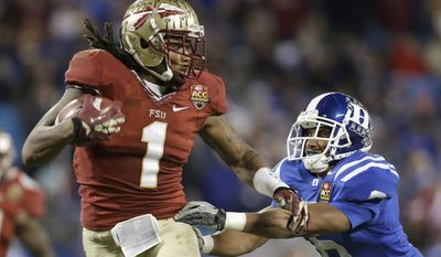 FILE - In this Dec. 7 2013, file photo, Florida State's Kelvin Benjamin (1) runs past Duke's Ross Cockrell (6) for a touchdown in the second half of the Atlantic Coast Conference Championship NCAA football game in Charlotte, N.C. Benjamin was selected in the first round, 28th overall, by the Carolina Panthers in the NFL draft on Thursday, May 8, 2014. (AP Photo/Bob Leverone, File)
