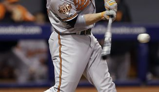 Baltimore Orioles' Steve Pearce lines a single off Tampa Bay Rays starting pitcher David Price during the fourth inning of a baseball game Thursday, May 8, 2014, in St. Petersburg, Fla. (AP Photo/Chris O'Meara)