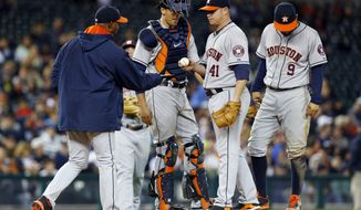 Houston Astros manager Bo Porter, left, takes the ball from Houston Astros pitcher Brad Peacock (41) against the Detroit Tigers in the seventh inning of a baseball game in Detroit, Wednesday, May 7, 2014. (AP Photo/Paul Sancya)