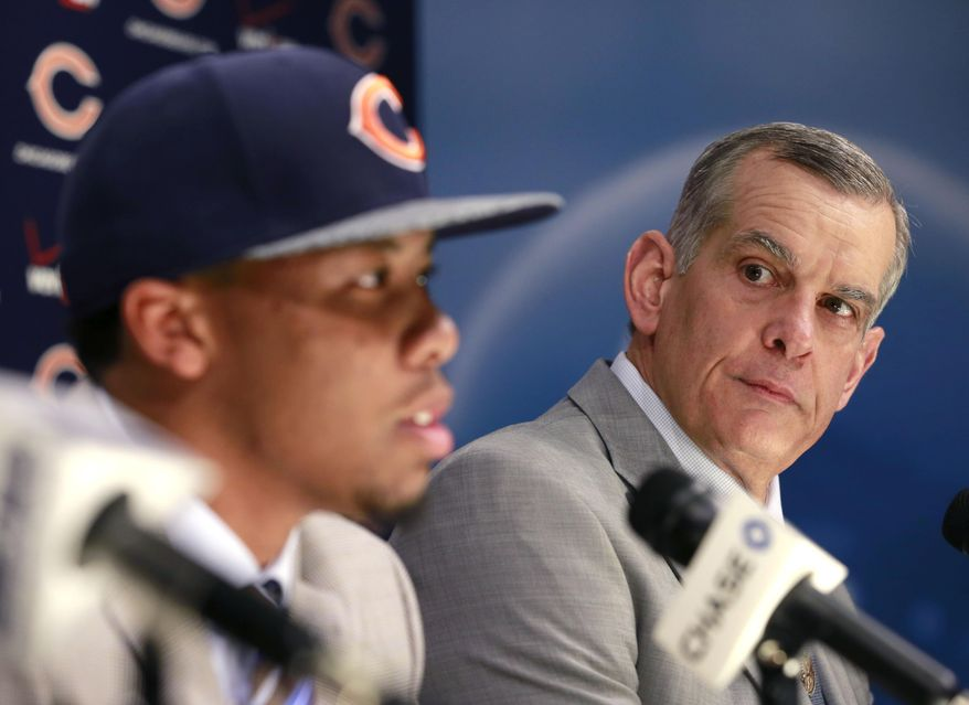 Chicago Bears general manager Phil Emery, right, listens to the Bears first round draft pick Virginia Tech cornerback Kyle Fuller during an NFL football news conference Friday, May 9, 2014, in Lake Forest. (AP Photo/Charles Rex Arbogast)