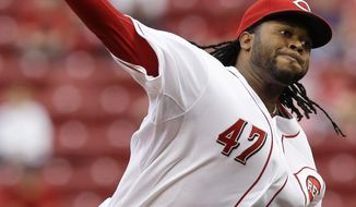 Cincinnati Reds starting pitcher Johnny Cueto throws against the Colorado Rockies in the first inning of a baseball game on Friday, May 9, 2014, in Cincinnati. (AP Photo/Al Behrman)