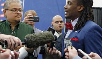 Denver Broncos first-round draft pick Ohio State cornerback Bradley Roby, right, is surrounded by members of the media at the NFL football team's headquarters in Englewood, Colo., Friday, May 9, 2014. (AP Photo/Ed Andrieski)
