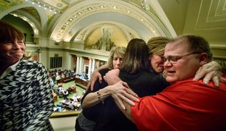 Medical marijuana advocates celebrate after the Minnesota House of Representatives passed a bill that would legalize marijuana use for medical reasons in a 86-39 vote at the Capitol in St. Paul, Minn. on Friday, May 9, 2014. (AP Photo/The Star Tribune, Glen Stubbe)