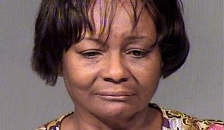 This photo provided by Maricopa Sheriffs office shows Marion Holmes.  Police spokeswoman Lisa Kutis said 60-year-old Marion Holmes was accused by a grand jury in Maricopa County Superior Court on 35 counts involving fraud, theft, forgery and other offenses.  Holmes allegedly misappropriated at least $529,000 from the Arizona School Choice Trust for personal use, Kutis said, Friday, May 9, 2014. (AP Photo/)