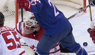 France's Antoine Roussel celebrates his team's first goal as Team Canada goalie James Reimer is down on the ice during first period action Friday, May 9, 2014 at the IIHF World Hockey Championship in Minsk Belarus.  (AP Photo/The Canadian Press, Jacques Boissinot)