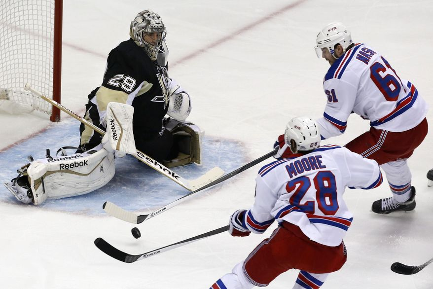 New York Rangers' Rick Nash (61) cannot get his stick on a puck in front of Pittsburgh Penguins goalie Marc-Andre Fleury (29) in the first period of Game 5 of a second-round NHL playoff hockey series in Pittsburgh, Friday, May 9, 2014. (AP Photo/Gene J. Puskar)