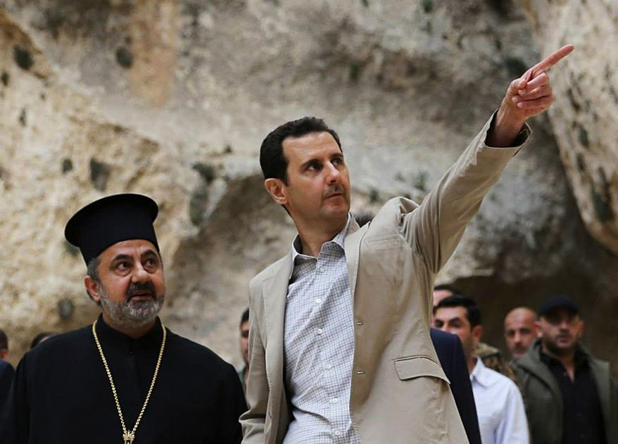 FILE - In this Sunday, April 20, 2014 file photo, released by the Syrian official news agency SANA, Syrian President Bashar Assad, right, visits the Christian village of Maaloula, near Damascus, Syria. Two years ago, it seemed almost inevitable that President Bashar Assad would be toppled. Almost no one thinks that now. As he prepares for elections through which he is set to claim another seven-year mandate for himself, the momentum in the civil war is clearly in Assad's favor. (AP Photo/SANA, File)