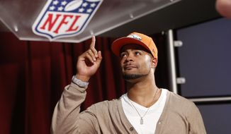 Indiana wide receiver Cody Latimer reacts after being selected by the Denver Broncos as the 56th pick during the second round of the 2014 NFL Draft, Friday, May 9, 2014, in New York. (AP Photo/Jason DeCrow)