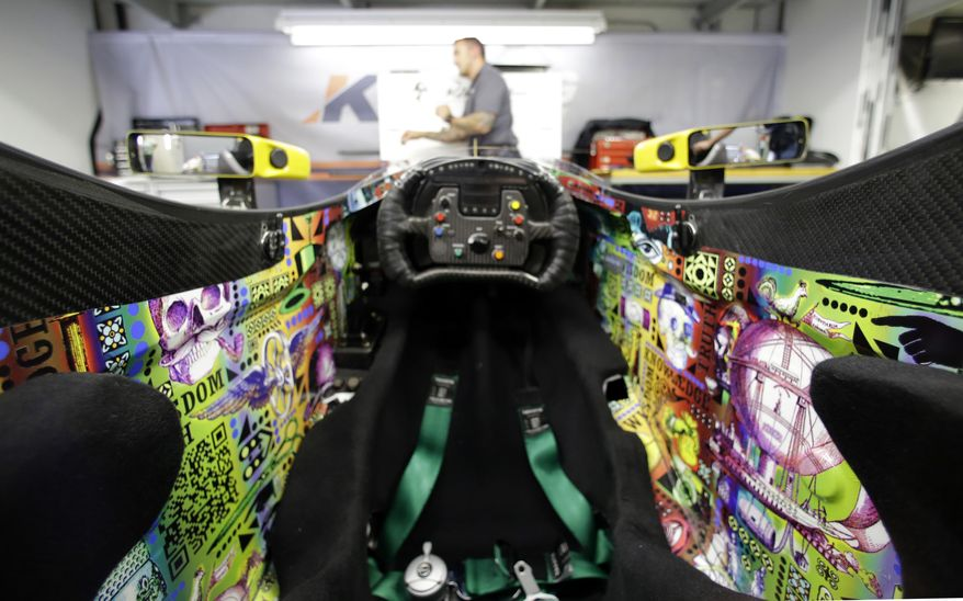 The cockpit of the car that will be driven by Townsend Bell for the Indianapolis 500 IndyCar auto race in shown in the team garage at the Indianapolis Motor Speedway in Indianapolis, Friday, May 9, 2014. (AP Photo/Michael Conroy)
