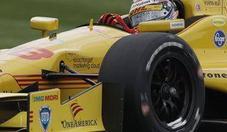 Ryan Hunter-Reay drives through a turn during qualifications for the inaugural Grand Prix of Indianapolis IndyCar auto race at the Indianapolis Motor Speedway in Indianapolis, Friday, May 9, 2014. (AP Photo/Darron Cummings)