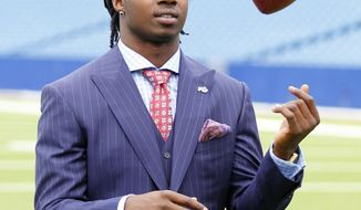 Buffalo Bills first round draft pick Sammy Watkins tosses a football during a photo opportunity at Ralph Wilson Stadium in Orchard Park, N.Y., Friday, May 9, 2014. (AP Photo/Bill Wippert)