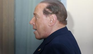 "Former Italian premier Silvio Berlusconi arrives at the ""Sacra Famiglia"" foundation in Cesano Boscone, near Milan, Italy, to carry out a court order to help the elderly, Friday, May 9, 2014. Berlusconi will help patients with Alzheimer disease for four hours per week as part of his punishment for tax fraud conviction. (AP Photo/Antonio Calanni)"