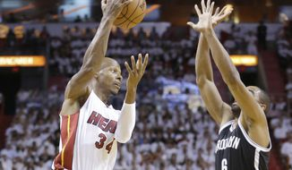 Miami Heat guard Ray Allen (34) attempts to pass past Brooklyn Nets forward Alan Anderson (6) during the first half of Game 2 of an Eastern Conference semifinal basketball game, Thursday, May 8, 2014 in Miami. (AP Photo/Wilfredo Lee)