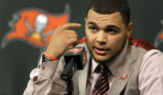 Tampa Bay Buccaneers first round draft pick Mike Evans gestures during an NFL football news conference Friday, May 9, 2014, in Tampa, Fla. Evans, a wide receiver from Texas A&M, was selected seventh overall in Thursday's draft. (AP Photo/Chris O'Meara)