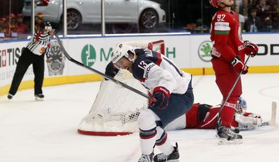 USA forward Colin McDonald celebrates his goal during the Group B preliminary round match between Belarus and USA at the Ice Hockey World Championship in Minsk, Belarus, Friday, May 9, 2014. (AP Photo/Darko Bandic)