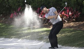 Martin Kaymer of Germany, hits from a sand trap on the 14th fairway during the second round of The Players championship golf tournament at TPC Sawgrass, Friday, May 9, 2014, in Ponte Vedra Beach, Fla. (AP Photo/John Raoux)