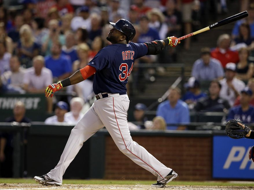 Boston Red Sox's David Ortiz follows through on a fly out to left off a pitch from Texas Rangers' Yu Darvish in the fourth inning of a baseball game, Friday, May 9, 2014, in Arlington, Texas. (AP Photo/Tony Gutierrez)