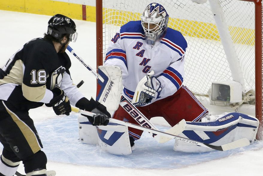 New York Rangers goalie Henrik Lundqvist (30) stops a shot by Pittsburgh Penguins' James Neal (18) in the first period of Game 5 of a second-round NHL playoff hockey series in Pittsburgh, Friday, May 9, 2014. (AP Photo/Gene J. Puskar)