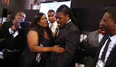 Jadeveon Clowney, from South Carolina, reacts with his mother Josenna Clowney after being selected number one overall by the Houston Texans in the first round of the NFL football draft, Thursday, May 8, 2014, at Radio City Music Hall in New York. (AP Photo/Jason DeCrow)