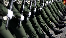 Russian troops march during the Victory Day Parade in Red Square in Moscow, Russia, Friday, May 9, 2014. Thousands of Russian troops marched on Red Square in the annual Victory Day parade in a proud display of the nation's military might amid escalating tensions over Ukraine.  (AP Photo/Pavel Golovkin)