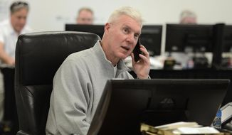 Green Bay Packers general manager Ted Thompson talks on the phone inside the war room at Lambeau Field in Green Bay, Wis., during the NFL Draft, Thursday, May 8, 2014. (AP Photo/Green Bay Press-Gazette, Evan Siegle) NO SALES