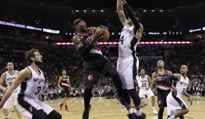 Portland Trail Blazers' Mo Williams (25) is defended by San Antonio Spurs' Danny Green (4) as he tries to score during the first half of Game 2 of a Western Conference semifinal NBA basketball playoff series, Thursday, May 8, 2014, in San Antonio.  (AP Photo/Eric Gay)