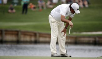 Phil Mickelson reacts as his putt misses for birdie on the 17th green during the second round of The Players championship golf tournament at TPC Sawgrass, Friday, May 9, 2014, in Ponte Vedra Beach, Fla. (AP Photo/John Raoux)