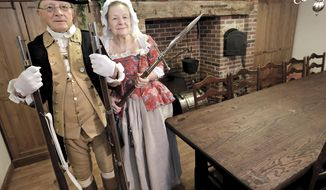 This April 17, 2014 photo shows Bill and Marilyn Hess,  Revolutionary War re-enactors photographed in their Janesville, Ind., basement. The Janesville couple have been Revolutionary War re-enactors since 1981 and are members of the North West Territory Alliance, a nonprofit educational organization that studies and re-creates the cultures, lifestyle and arts of the time of the American Revolution, 1775-1783. The alliance strives to duplicate the uniforms, weapons, battlefield tactics and camp life of the era as accurately as possible, Bill said. (AP Photo/The Janesville Gazette, Dan Lassiter)