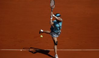 Na Li from China returns the ball during a Madrid Open tennis tournament match against Sloane Stephens from U.S. in Madrid, Spain, Thursday, May 8, 2014 . (AP Photo/Daniel Ochoa de Olza)
