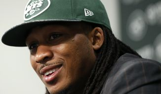 Calvin Pryor, who was drafted by the New York Jets with the 18th pick in the first round of the NFL football draft the night before, talks to the media, Friday, May 9, 2014, in Florham Park, N.J. (AP Photo/Julio Cortez)