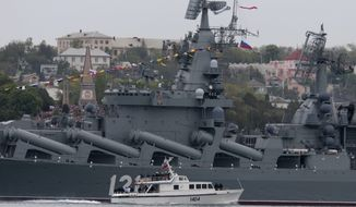 Russian President Vladimir Putin, on a boat, inspects the missile cruiser Moskva during a navy parade marking the Victory Day in Sevastopol, Crimea, Friday, May 9, 2014. Putin extolled the return of Crimea to Russia before tens of thousands Friday during his first trip to Black Sea peninsula since its annexation.  The triumphant visit was quickly condemned by Ukraine and NATO.  (AP Photo / Ivan Sekretarev) ** FILE **