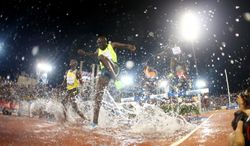 Athletes compete in the men's 3,000m steeplechase at the IAAF Diamond League in the Qatari capital Doha, Friday May 9, 2014. (AP Photo/Osama Faisal)