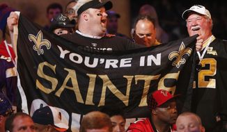 New Orleans Saints fans cheer as the Saints' select Stanley Jean-Baptiste as the 58th selection the second round of the 2014 NFL Draft, Friday, May 9, 2014, in New York. (AP Photo/Jason DeCrow)