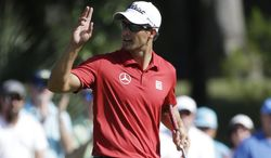 Adam Scott of Australia, waves after making a birdie putt on the 14th hole during the second round of The Players championship golf tournament at TPC Sawgrass, Friday, May 9, 2014 in Ponte Vedra Beach, Fla. (AP Photo/John Raoux)