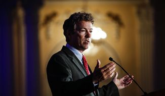 Kentucky Senator Rand Paul address attendees during the Republican National Committee spring meeting at the Peabody hotel in Memphis, Tenn., on Friday, May 9, 2014.  Paul urged members to rethink policies on national security and drug prosecutions (AP Photo/The Commercial Appeal, William DeShazer)