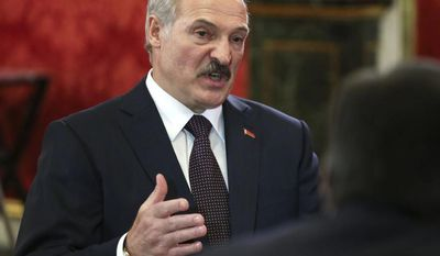 Belarusian President Alexander Lukashenko speaks at a meeting of the leaders of the member states of the Collective Security Treaty Organization (CSTO)  in the Kremlin in Moscow, Russia, Thursday, May 8, 2014. (AP Photo/Sergei Karpukhin, Pool)