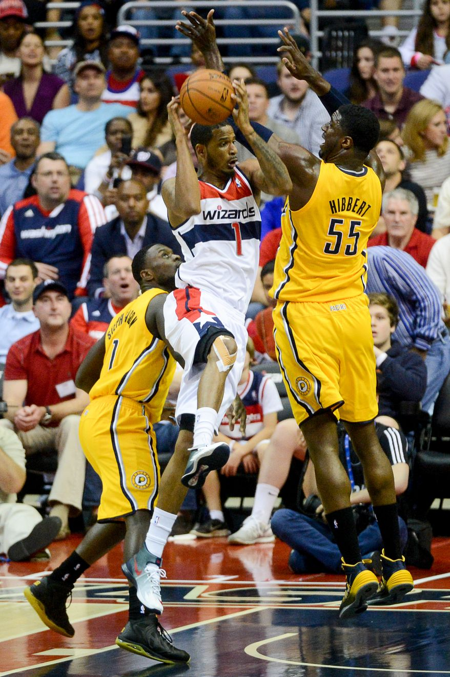 Washington Wizards forward Trevor Ariza (1) takes a shot between Indiana Pacers guard Lance Stephenson (1), left, and Indiana Pacers center Roy Hibbert (55), right, in the first quarter as the Washington Wizards play the Indiana Pacers in game 3 during the second round of the Eastern Conference Semifinal NBA basketball playoffs at the Verizon Center, Washington, D.C., Friday, May 9, 2014. (Andrew Harnik/The Washington Times)
