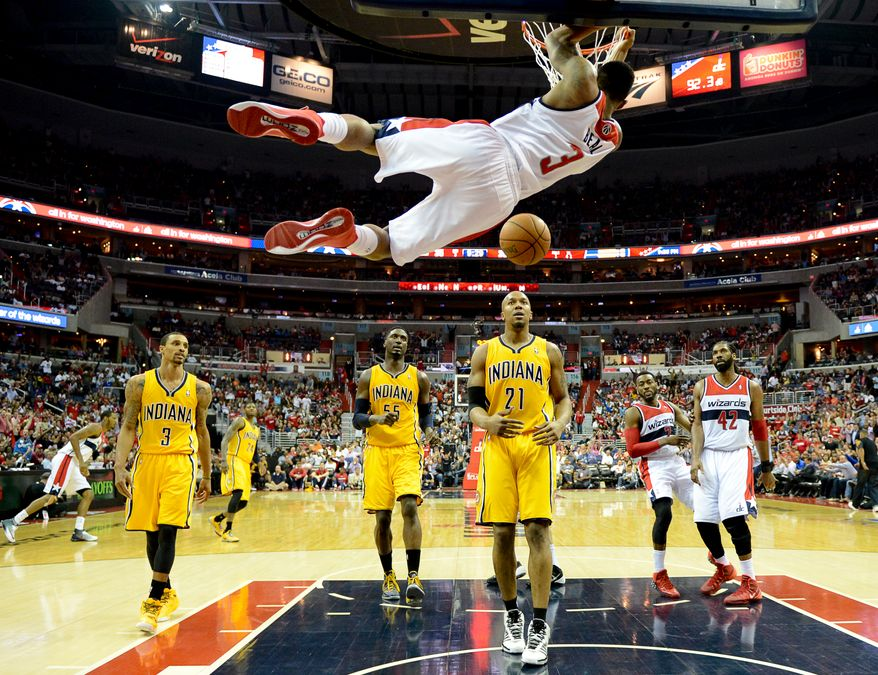 Washington Wizards guard Bradley Beal (3) dunks from an assist by Washington Wizards guard John Wall (2) in the first half as the Washington Wizards lose to the Indiana Pacers 85-63 in game 3 during the second round of the Eastern Conference Semifinal NBA basketball playoffs at the Verizon Center, Washington, D.C., Friday, May 9, 2014. (Andrew Harnik/The Washington Times)